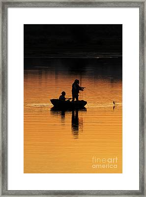 A Simple Catch Framed Print by Tim Gainey