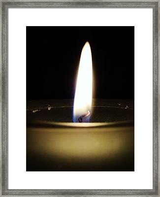 A Single Flame Framed Print by Zinvolle Art