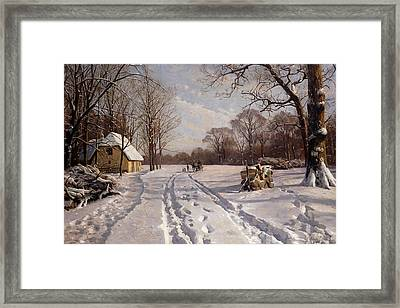 A Sleigh Ride Through A Winter Landscape Framed Print by Peder Monsted