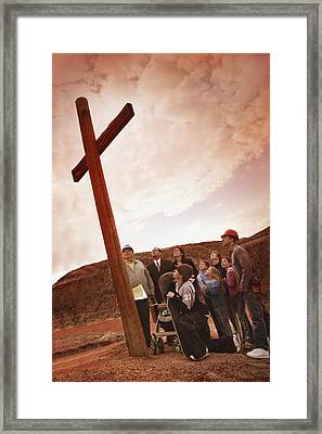 A Small Crowd Gathered At A Wooden Cross Framed Print by Don Hammond