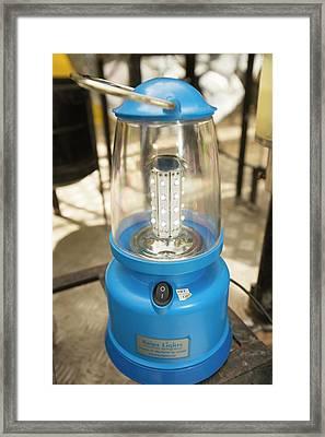 A Solar Lantern Powered By A Solar Panel Framed Print