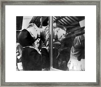 A Soldier's Double Kiss Framed Print by Underwood Archives