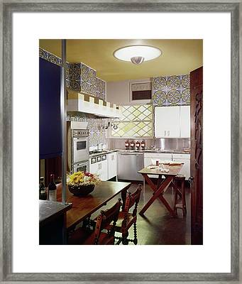 A Spanish-style Kitchen Framed Print