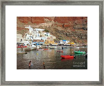 A Splash In Amoudi Bay  Framed Print