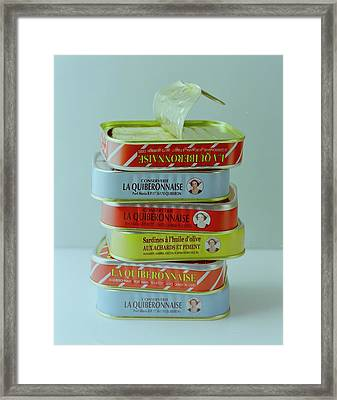 A Stack Of Cans Of Sardines Framed Print by Romulo Yanes