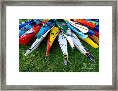 A Stack Of Kayaks Framed Print by Amy Cicconi