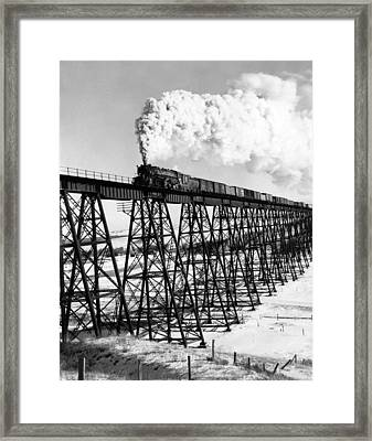 A Steam Engine On Trestle Framed Print by Underwood Archives