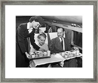 A Stewardess Serving Breakfast Framed Print by Underwood Archives