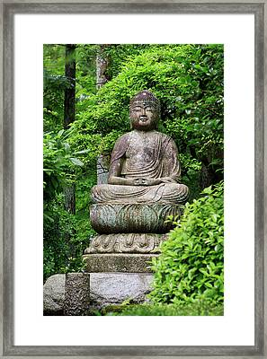 A Stone Buddha Statue In The Grounds Framed Print by Paul Dymond