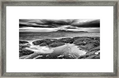 A Storm Brewing Framed Print by John Farnan
