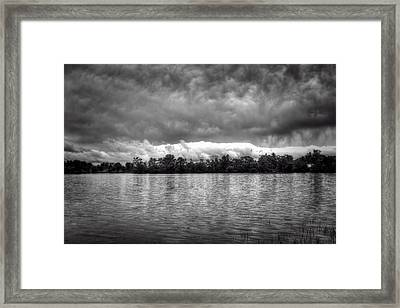 A Storm Rolls By Framed Print by Thomas Young