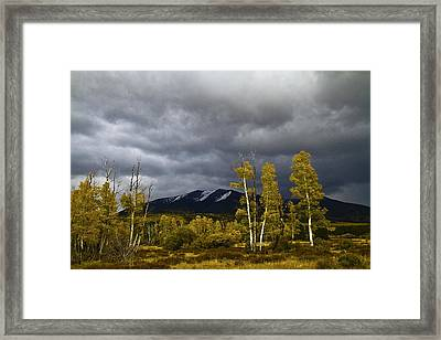 Framed Print featuring the photograph A Stormy Day At The Peaks by Tom Kelly
