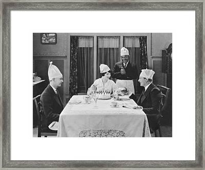 A Strange Birthday Party Scene Framed Print by Underwood Archives