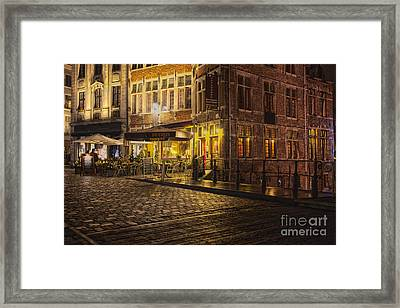 A Streetscene At Night In Europe Framed Print