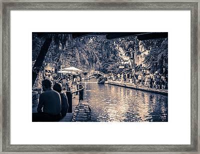 A Stroll On The Riverwalk Framed Print