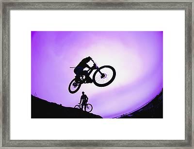 A Stunt Cyclist Silhouette Framed Print