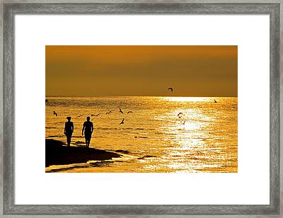 A Sunset Walk Framed Print