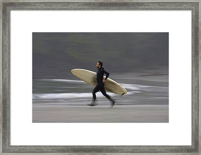 A Surfer Running To The Water With His Framed Print by Deddeda