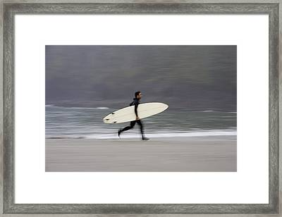 A Surfer, Running With Board Along The Framed Print by Deddeda