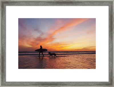 A Surfer Walks In Shallow Water With Framed Print