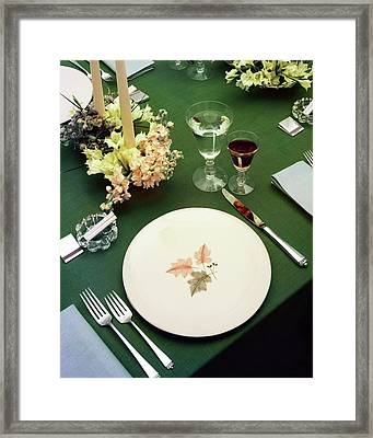 A Table Setting On A Green Tablecloth Framed Print