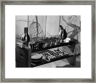 A Table With Tableware And Snacks Framed Print