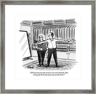 A Tailor Is Consulting With A Male Client Framed Print