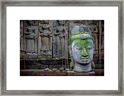 A Terra Cotta Head Of Buddha Sits Framed Print