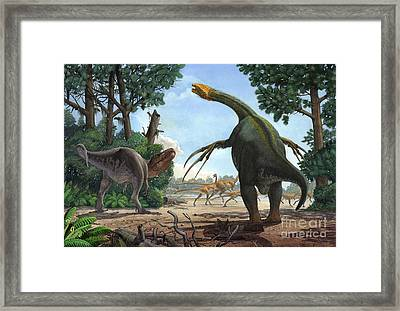 A Therizinosaurus Prevents A Young Framed Print by Sergey Krasovskiy
