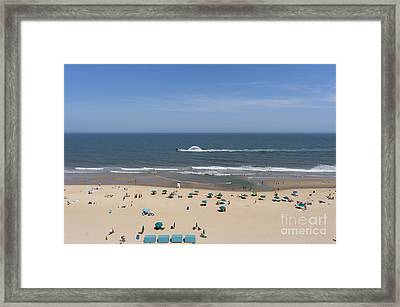 A Touring Speedboat Passes By Shore In Ocean City Maryland Framed Print