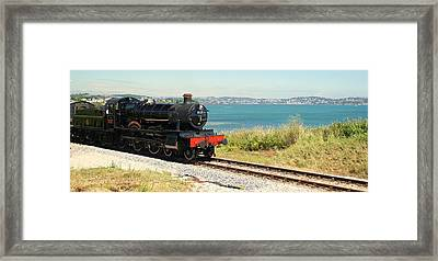 A Train Ride By The Sea Framed Print by Peter Hunt