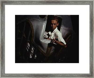 A Trainee Working Inside The Nose Cone Framed Print by Stocktrek Images