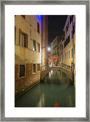 A Tranquil Canal Between Buildings Framed Print