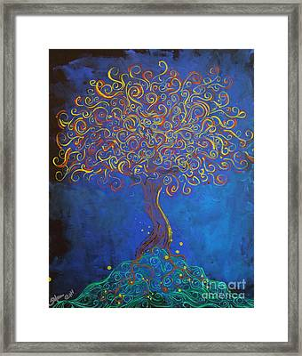 A Tree Of Orbs Glows Framed Print