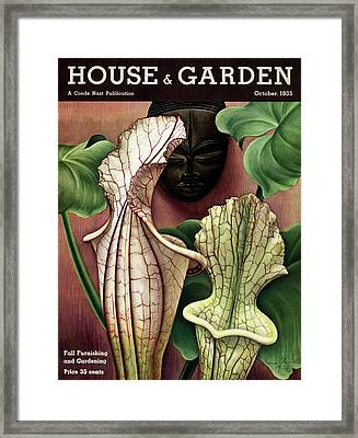A Tropical Flower And An African Mask Framed Print