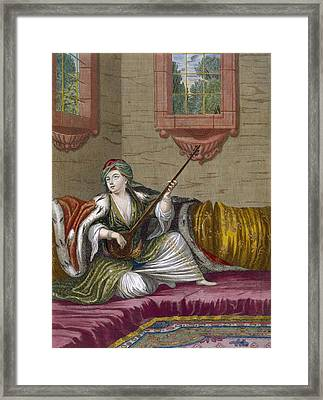 A Turkish Girl Playing The Tehegour Framed Print by French School