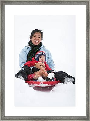 A Two Year Old Boy, Sleds Framed Print