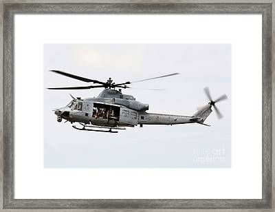 A Uh-1y Huey Hovers Around A Ship Framed Print by Stocktrek Images