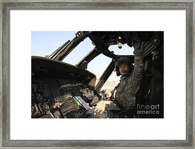 A Uh-60 Black Hawk Helicopter Framed Print