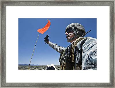 A U.s. Air Force Member Uses Framed Print by Stocktrek Images