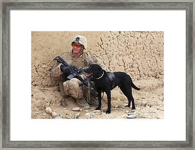 A U.s. Marine Dog Handler And His Dog Framed Print