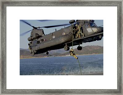 A U.s. Navy Seal Fast-ropes Framed Print by Stocktrek Images