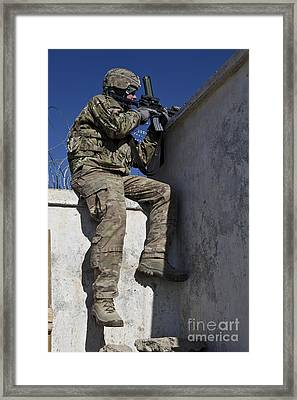 A U.s. Soldier Provides Security At An Framed Print