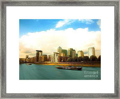 A View Over The River Thames Of Canary Wharf London Docklands England Framed Print by Flow Fitzgerald