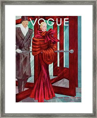 A Vogue Cover Of A Couple In A Revolving Door Framed Print by Georges Lepape