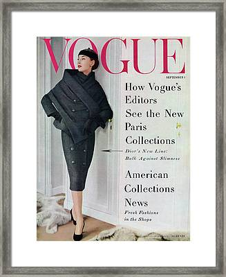 A Vogue Cover Of A Model Wearing A Dior Suit Framed Print by Henry Clarke
