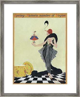 A Vogue Cover Of A Woman Holding A Doll Framed Print by Helen Dryden