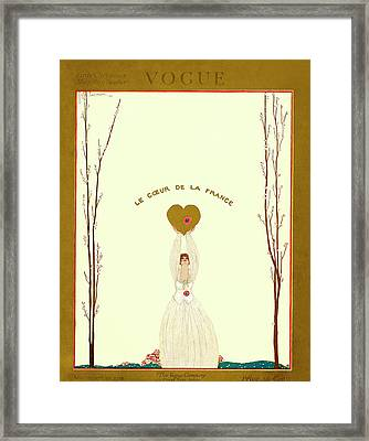 A Vogue Cover Of A Woman Holding A Gold Heart Framed Print