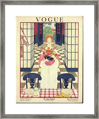 A Vogue Cover Of A Woman Holding Flowers Framed Print by George Wolfe Plank