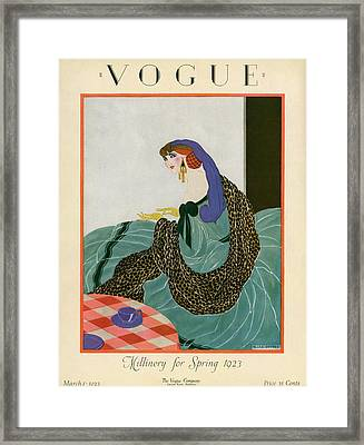 A Vogue Cover Of A Woman Putting On Gloves Framed Print by Helen Dryden